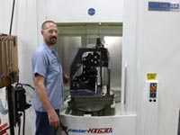 Steve Pleshek works with Mod Tech's computer-controlled machining equipment. Mod Tech was able to expand with the help of a loan package put together by Associated Bank in partnership with a USDA loan program, and the company now employs 70 people.