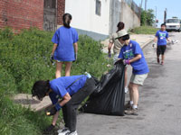 Volunteers help clear debris as part of the street-to-street cleanup of the Ivy City neighborhood.